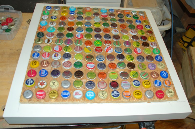 12 bottlecaps glued 800x528 DIY Cheap and Chic Bottlecap Table