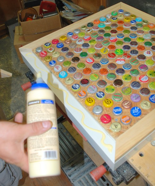16 glue band 1 500x600 DIY Cheap and Chic Bottlecap Table
